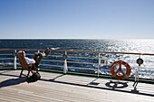 Man relaxing on deck of cruiseship MS Deutschland (Deilmann Cruises), South Atlantic Ocean, South America, America