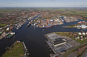 Aerial view of Emden seaport and the river Ems, harbour with container terminal, oil containers and export vehicles, Emden, Lower Saxony, northern Germany