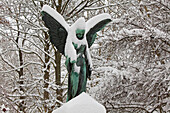 Snow-covered angel statue, Linden mountain cemetery, Hanover, Lower Saxony, Germany