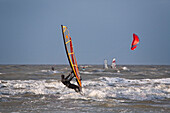 Wind surfers and kite surfer, St Peter-Ording, Schleswig-Holstein, Germany