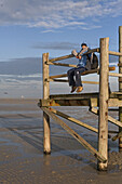 Person on an observation platform at low tide, St Peter-Ording, North Sea, Schleswig-Holstein, northern Germany