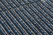 aerial of many parked vehicles at Volkswagen automobile plant, Wolfsburg, Lower Saxony Germany