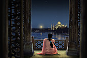 Woman in traditional costume looking at full moon and Taj Mahal, Agra, Uttar Pradesh, India, Asia