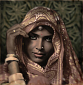 Beautiful young woman in a veil at a royal court in Rajasthan, India, Asia