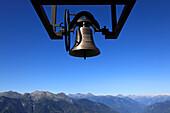 Bell at chapel Santa Maria degli Angeli, (Architect: Mario Botta), Alpe Foppa, hike in the mountains to Monte Tamaro, Ticino, Switzerland