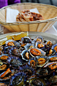A plate of mussels, Lapas in a restaurant in Funchal, Madeira, Portugal