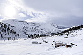 Alpine huts, Kleine Fanesalm in winter, natural park Fanes-Sennes, UNESCO World Heritage Site, Dolomites, South Tyrol, Italy