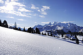 Wide field of snow with Cristallo mountain range in the background, Plaetzwiese, Fanes-Sennes natural park, UNESCO World Heritage Site, Dolomites, South Tyrol, Italy