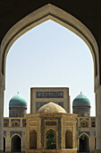 Kalon Mosque with the turquoise domes of the Mir_i_Arab Medressa, Bukhara, Uzbekistan, Central Asia