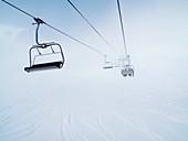 Chair lift, Cloudy, Cold, Color, Holidays, Horizontal, Ski, Ski station, Snow, Winter, L55-955879, agefotostock