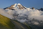 Clouds dissipating in the evening around Mount Baker elevation 10,778feet 3,285m  Seen from Chowder Ridge, Mount Baker Wilderness Washington USA