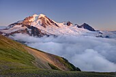 Clouds dissipating in the evening light around Mount Baker elevation 10,778 feet 3,285 m  Seen from Chowder Ridge, Mount Baker Wilderness Washington USA