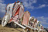 Typical carriages, ´romería´  pilgrimage) to El Rocio. Almonte, Huelva province, Andalucia, Spain