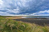 Embleton Bay near Dunstanburgh Castle, Northumberland, England, UK
