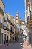 Street and church of Nuestra Señora de la Encarnacion, Olvera. White Towns of Andalusia, Cadiz province, Andalusia, Spain
