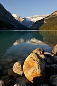 Sunrise and moutains reflecting in Lake Louise, Banff National Park, Rocky Mountains, Alberta, Canada