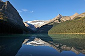 Mount Victoria reflecting in the calm water, Lake Louise, Banff National Park, Rocky Mountains, Alberta, Canada