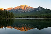 Sunrise at Pyramid Lake with Mount Pyramid reflecting in the calm water  Jasper National Park, Rocky Mountains, Alberta, Canada