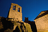 Night view of the San Juan Bautista Chuch wit the Trevejo Castle behind  Trevejo  Villamiel  Sierra de Gata  Caceres province  Extremadura  Spain