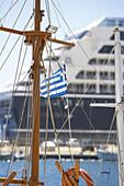 Mast with Greek Flag in Harbour of Mykonos Island, Greece