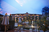 View into the yard and cafe in the evening, Hotel Giardino, Ascona, Ticino, Switzerland