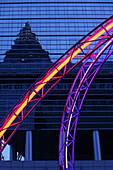 Neon light sculpture against high rise building,  Frankfurt am Main, Hesse, Germany