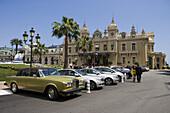Luxury cars parked outside Monte Carlo Casino, Monte Carlo, Monaco