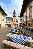 View along pedestrian area to St. Peter and Paul's church, Mittenwald, Upper Bavaria, Germany