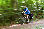 Cyclist passing Isar Cycle Route, Strasslach-Dingharting, Upper Bavaria, Germany