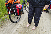 Wet cyclist, Isar Cycle Route, near Moosburg, Upper Bavaria, Germany