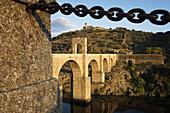 Roman bridge built by architect Caius Iulius Lacer and convent in background, Alcantara. Caceres province, Extremadura, Spain