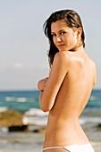 Portrait of a beautiful brunette in the beach