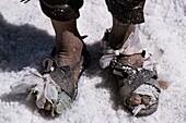 Bolivia, Salar of Uyuni, The feet of a salt worker