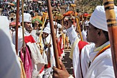 Ethiopia, Lalibela,Timkat festival, Ritual dance of the Dabtaras choristers  Every year on january 19, Timkat marks the Ethiopian Orthodox celebration of the Epiphany  The festival reenacts the baptism of Jesus in the Jordan River  Wrapped in rich cloth