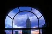 New York, NY - The Empire State Building, framed by a window in a Manhattan office building  Copyright Jim West