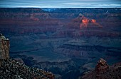 Grand Canyon National Park, Arizona - Early morning sunlight strikes Isis Temple in the Grand Canyon  © Jim West