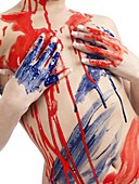 Woman body covered in red and blue paint strokes