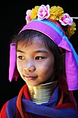 Portrait of a young Longneck girl  Approximately 300 Burmese refugees in Thailand are members of the indigenous group known as the Longnecks  The largest of the three villages where the Longnecks live is called Nai Soi, located near Mae Hong Son City  Lon