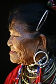Profile closeup of an older Longneck woman  Approximately 300 Burmese refugees in Thailand are members of the indigenous group known as the Longnecks  The largest of the three villages where the Longnecks live is called Nai Soi, located near Mae Hong Son