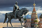 Monument of Youri Dolgorukiy and St  Basil cathedral on the dramatic sky background