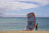 Surfer with kite at Kanaha Beach Park, Maui, Hawaii, USA, America