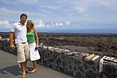 Young couple posing at a wall, Big Island, Hawaii, USA, America