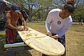 Local people making a traditional surfboard, Waikiki Beach, Honolulu, Oahu, Hawaii, USA, America