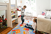 Two children playing in child's room, Hamburg, Germany