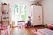 Girl playing in child's room, Hamburg, Germany