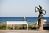 Man sitting on a bank while looking at view, Timmendorfer Strand, Schleswig-Holstein, Germany