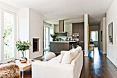 Modern living area with fireplace and kitchen, Hamburg, Germany
