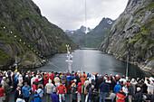 Passengers aboard Cruiseship MS Astor admire narrow Fjord, Trollfjord, Finnmark, Norway, Europe