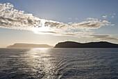 Wind Wheels on Peninsula & Midnight Sun, near North Cape, Finnmark, Norway, Europe