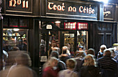 Passers-by and visitors in front of an Irish pub, Fleet Street, Temple Bar area, Dublin, County Dublin, Ireland